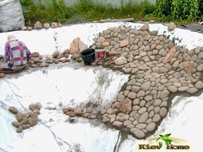 укладка декоративного камня в пруду